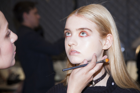 catwalk model: New York, NY, USA - February 11, 2016: A model prepares backstage at the Desigual runway show during of Fall 2016 New York Fashion Week at The Arc, Skylight at Moynihan Station, Manhattan.