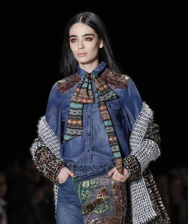 New York, NY, USA - February 11, 2016: A model walks the runway at the Desigual runway show during of Fall 2016 New York Fashion Week at The Arc, Skylight at Moynihan Station, Manhattan.