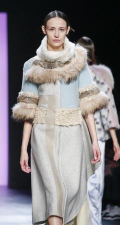 jung: New York, NY, USA - February 13, 2016: A model walks the runway at the Son Jung Wan runway show during of FallWinter 2016 New York Fashion Week at The Dock, Skylight at Moynihan Station, Manhattan.
