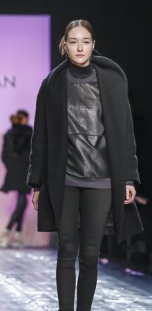 jung: New York, NY, USA - February 13, 2016: A model walks the runway rehearsal at the Son Jung Wan runway show during of FallWinter 2016 New York Fashion Week at The Dock, Skylight at Moynihan Station, Manhattan.