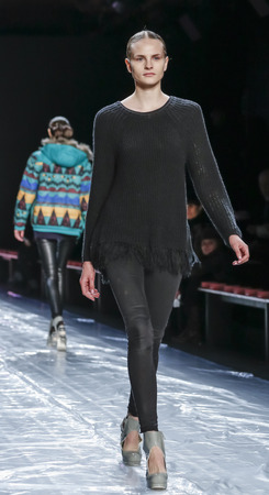 jung: New York, NY, USA - February 13, 2016: A model walks the runway rehearsal at the Son Jung Wan runway show during of FallWinter 2016 New York Fashion Week at The Dock, Skylight at Moynihan Station, Manhattan.