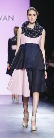 jung: New York, NY, USA - February 13, 2016: A model walks runway at the Son Jung Wan runway show during of FallWinter 2016 New York Fashion Week at The Dock, Skylight at Moynihan Station, Manhattan.