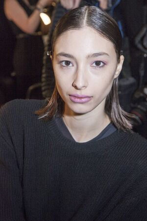 alexandra: New York, NY, USA - February 13, 2016: Alexandra Agoston prepares backstage at the Son Jung Wan runway show during of FallWinter 2016 New York Fashion Week at The Dock, Skylight at Moynihan Station, Manhattan. Editorial