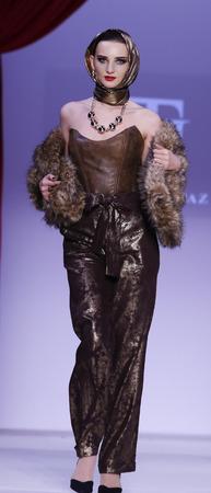 New York, NY, USA - February 14, 2016: A model walks the runway at the David Tupaz runway show during of Fall/Winter 2016 New York STYLE Fashion Week at Gotham Hall, Manhattan.