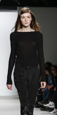 New York, NY, USA - February 14, 2016: A model walks runway rehearsal at  Jenny Packham runway show during of Fall/Winter 2016 New York Fashion Week at The Gallery, Skylight Clarcson Sq., Manhattan.