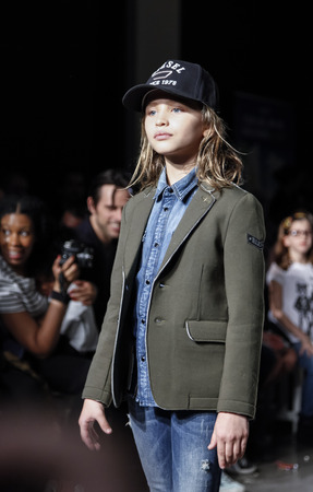 New York, NY, USA - March 12, 2016: A model walks the runway for DIESEL KID collection at petitePARADE / Kids Fashion Week New York at Spring Studios, Manhattan. Reklamní fotografie - 54012050
