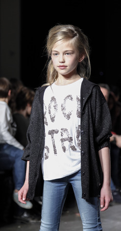 New York, NY, USA - March 12, 2016: A model walks the runway for DIESEL KID collection at petitePARADE / Kids Fashion Week New York at Spring Studios, Manhattan.