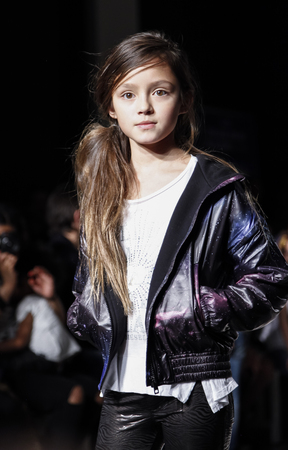 fashion: New York, NY, USA - March 12, 2016: A model walks the runway for DIESEL KID collection at petitePARADE  Kids Fashion Week New York at Spring Studios, Manhattan. Editorial