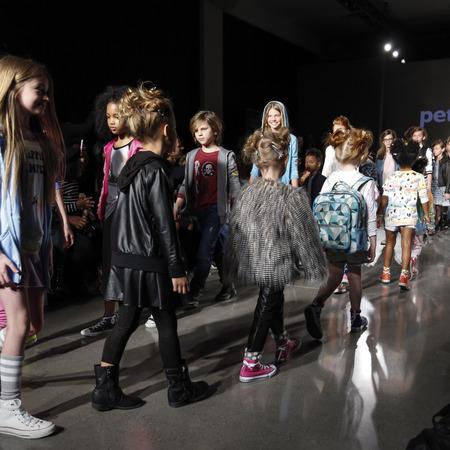 New York, NY, USA - March 12, 2016: Models walk the runway at petitePARADE  Kids Fashion Week New York at Spring Studios, Manhattan.