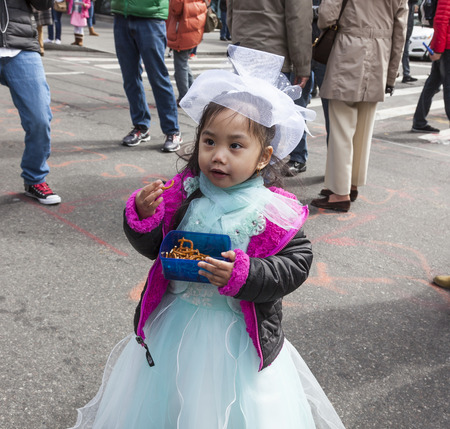 bonnet: New York, NY, USA - March 27, 2016: Unidentified people in costumes attend 2016 New York Easter Parade and Bonnet Festival on 5th Avenue, Manhattan.