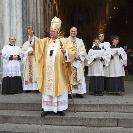 New York, NY, USA - March 27, 2016: Archbishop of New York Cardinal Dolan greets worshipers and guests on the steps of Saint Patricks Cathedral in Manhattan after Easter mass