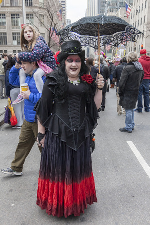 religious clothing: New York, NY, USA - March 27, 2016: Unidentified people in costumes attend 2016 New York Easter Parade and Bonnet Festival on 5th Avenue, Manhattan.