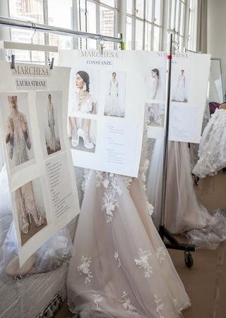 craig: New York, NY, USA - April 13, 2016: Rack eith dresses on backstage for Marchesa SS17 2016 Bridal Presentation at Canoe Studio, Manhattan Editorial