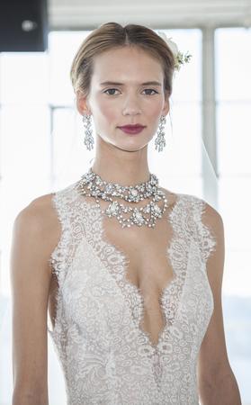 craig: New York, NY, USA - April 13, 2016: A model shows up a wedding dress for Marchesa SpringSummer 2017 Bridal Presentation at Canoe Studio, Manhattan Editorial