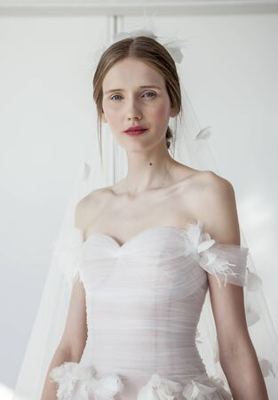 chapman: New York, NY, USA - April 13, 2016: A model shows up a wedding dress for Marchesa SpringSummer 2017 Bridal Presentation at Canoe Studio, Manhattan Editorial