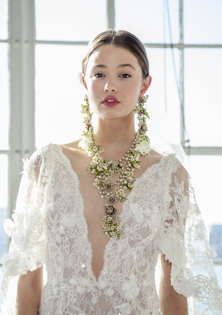 catwalk model: New York, NY, USA - April 13, 2016: A model shows up a wedding dress for Marchesa SpringSummer 2017 Bridal Presentation at Canoe Studio, Manhattan Editorial
