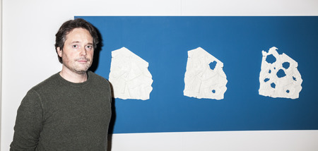 New York, NY, USA - May 3, 2016: Artist Piers Secunda displays his artwork ISIS Bullet Hole Painting during VIP preview at the Art New York, CONTEXT New York, Pier 94, Manhattan