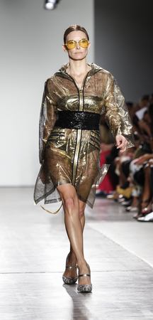 New York, NY, USA - September 11, 2016: A model walks runway for the Custo Barcelona womens & mens SpringSummer 2017 runway show during New York Fashion Week SS 2017 at Pier 59 Studios at Chelsea Piers, Manhattan