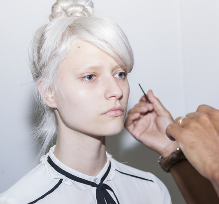 whit: New York, NY, USA - September 7, 2016: A model prepares backstage for the WHIT Spring?Summer 2017 collection presentation during New York Fashion Week SS 2017 at The New York Academy of Art