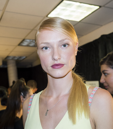ss: New York, NY, USA - September 8, 2016: A model prepares backstage for the Ninth Annual Supima Design competition during New York Fashion Week SS 2017 at The Gallery at Skylight Clarkson Sq