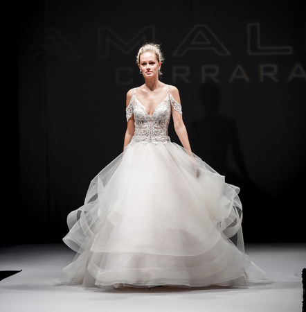 New York, NY, USA - October 8, 2016: A model walks runway for Eve of Milady / Amalia Carrara Spring  2017 Bridal Collection during New York International Bridal Week at the Fashion Theater, Pier 94, Manhattan 新闻类图片