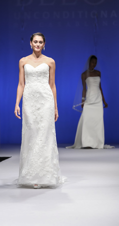 New York, NY, USA - October 8, 2016: A model walks runway for Casablanca Bridal Spring 2017 Beloved Collection during New York International Bridal Week at the Fashion Theater, Pier 94, Manhattan