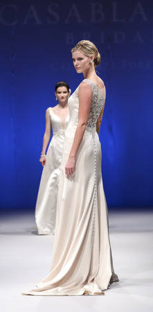New York, NY, USA - October 8, 2016: A model walks runway for Casablanca Bridal Spring 2017 Collection during New York International Bridal Week at the Fashion Theater, Pier 94, Manhattan Editorial