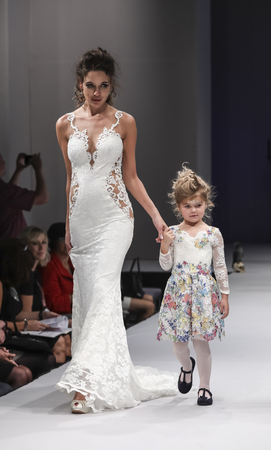 New York, NY, USA - October 8, 2016: Models walk runway for Olvis by Olga Yermoloff Spring 2017 Collection Alchemy during New York International Bridal Week at the Fashion Theater, Pier 94, Manhattan