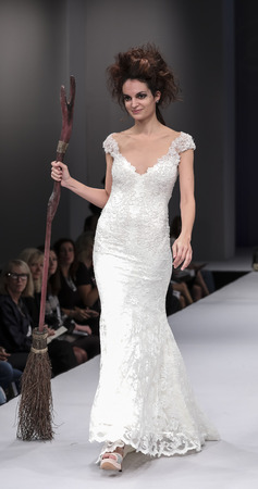 New York, NY, USA - October 8, 2016: A model walks runway for Olvis by Olga Yermoloff Spring 2017 Collection Alchemy during New York International Bridal Week at the Fashion Theater, Pier 94, Manhattan
