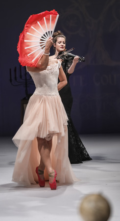 violin player: New York, NY, USA - October 8, 2016: Violin player Emily Holden and Ballerina: Shoko Tamai perform on the runway for Olvis by Olga Yermoloff Spring 2017 Collection Alchemy during New York International Bridal Week at the Fashion Theater, Pier 94, Manha Editorial
