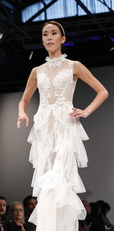 couture: New York, NY, USA - October 9, 2016: A model walks runway for Bridal Couture from Israel Spring  2017 Bridal Collection during New York International Bridal Week at the Fashion Theater, Pier 94, Manhattan. Design by Shlomit Azrad