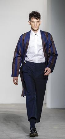 New York, NY, USA - January 31, 2017: A model walks runway for Carlos Campos FW17 runway show during NY Fashion Wweek: Mens at Skylight Clarkson Sq., North, Manhattan