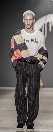 cooper: New York, NY, USA - February 1, 2017: A model walks runway rehearsal for Rochambeau FW17 runway show during NY Fashion Week: Mens at Skylight Clarkson Sq., North, Manhattan Editorial