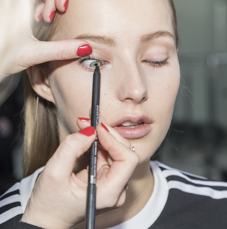 couture: New York, NY, USA - February 10, 2017: A model prepares backstage for Oday Shakar FW17 collection runway show during New York Fashion Week at Pier 59 Studios, Manhattan