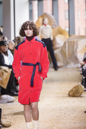 New York, NY, USA - February 11, 2017: A model walks runway for Lacoste FW 2017 collection runway show during New York Fashion Week at Pier 59 Studios, Manhattan
