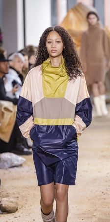 New York, NY, USA - February 11, 2017: A model walks runway for Lacoste FW17 collection runway show during New York Fashion Week at Pier 59 Studios, Manhattan