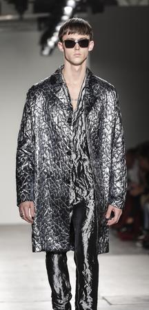 New York, NY, USA - February 12, 2017: Model walks runway for the Custo Barcelona FallWinter 2017 runway show during New York Fashion Week at Pier 59 Studios at Chelsea Piers, Manhattan