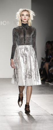 winter fashion: New York, NY, USA - February 13, 2017: A model walks runway for the Katty Xiomara FallWinter 2017 runway show during New York Fashion Week at Pier 59 Studios at Chelsea Piers, Manhattan