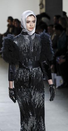 14: New York, NY, USA - February 14, 2017: A model walks runway for Anniesa Hasibuan FW17 collection runway show during New York Fashion Week at Skylight Clarkson Sq., Manhattan