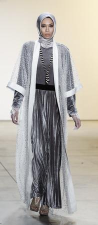 New York, NY, USA - February 14, 2017: A model walks runway for Anniesa Hasibuan FW17 collection runway show during New York Fashion Week at Skylight Clarkson Sq., Manhattan