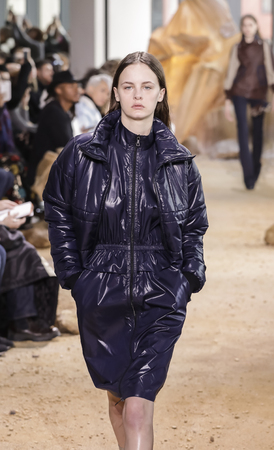 couture: New York, NY, USA - February 11, 2017: A model walks runway for Lacoste FallWinter 2017 collection runway show during New York Fashion Week at Spring Studios, Manhattan