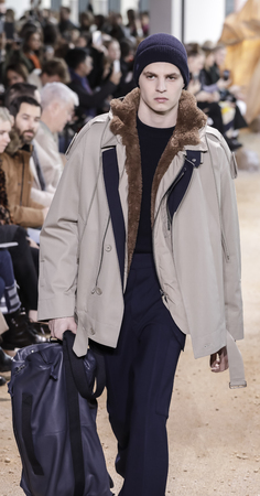 New York, NY, USA - February 11, 2017: A model walks runway for Lacoste FallWinter 2017 collection runway show during New York Fashion Week at Spring Studios, Manhattan