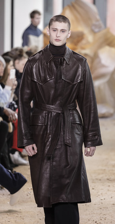 couture: New York, NY, USA - February 11, 2017: A model walks runway for Lacoste FW17 collection runway show during New York Fashion Week at Spring Studios, Manhattan Editorial