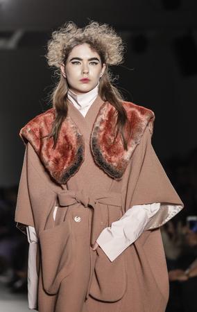 New York, NY, USA - February 13, 2017: Models walk runway for the Katty Xiomara FallWinter 2017 runway show during New York Fashion Week at Pier 59 Studios at Chelsea Piers, Manhattan