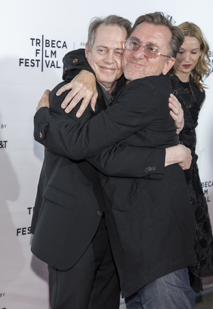 roth: New York, NY, USA - April 26, 2017: Tim Roth hugs Steve Buscemi at 25th Anniversary Retrospective Screening of Reservoir Dogs at The 2017 Tribeca Film Festival at Beacon Theatre, Manhattan