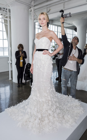 New York, NY, USA - April 20: A model shows out a dress by Georgina Chapman and Keren Craig for Marchesa SpringSummer 2018 Bridal Presentation during New York International Bridal Week at Canoe Studi