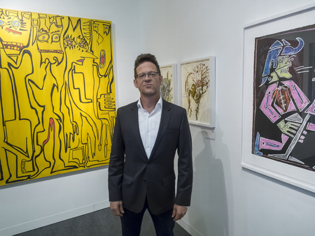 New York, NY, USA - May 3, 2017: Former Metallica bass guitarist Jason Newsted debuts his first art exhibition RAWK during VIP preview at the contemporary Art Fairs: Art New York, Context New York 2017, Pier 94, Manhattan Editorial