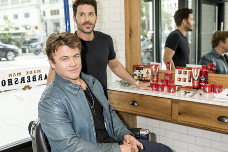 New York, NY, USA - May 11, 2017: Old Spice and Actor Luke Hemsworth (Westworld) Team Up with Celebrity Groomer Benjamin Thigpen to Teach Guys How to Get a HAIR of Confidence at Made Man Barber Shop, Manhsttan