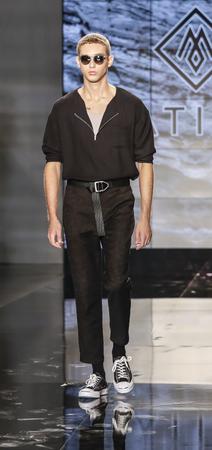 New York, NY, USA - July 12, 2017: A model walks the runway for Matiere SpringSummer 2018 Runway Presentation during New York Fashion Week: Mens at Cadillac House, NYC