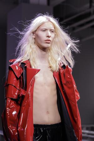 New York, NY, USA - July 11,2017: Amodel walks the runway for N-p-Elliott Runway Show during New York Fashion Week: Mens at Skylight Clarkson Square, NYG